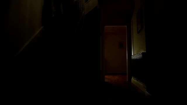 Walking downstairs in darkness. video