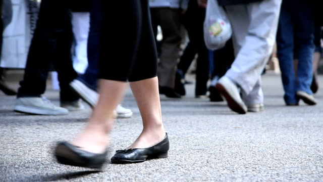Walking Feet on a Busy City Street with Audio video