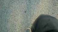 Walking feet on sidewalk slow motion video