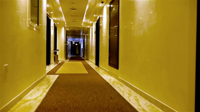 Walking in a long light corridor of a hotel video