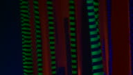 Walking in the dark through glowing fabrics video