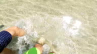 Walking in the sea. Slow motion video