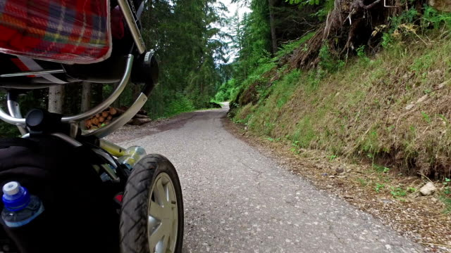 Walking on mountain road with baby stroller - Dolomites - Italy video