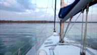 Walking on water. View from the stem of yacht. Close up video