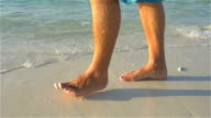 SLOW MOTION: Walking on white sand beach in shallow water video