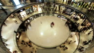 Walking people shopping in differents floors video