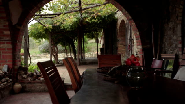 Walking throw beautiful rural scenic farm-house arbor outdoor in Tuscany, Italy - slow-motion gimbal steadicam establishing HD video footage video
