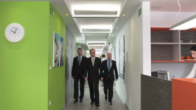 HD DOLLY: CEO Walking With Two Executive Assistants video