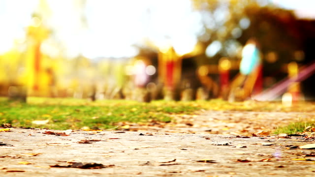 Walkway leads to the children's playground: unfocused bokeh background video