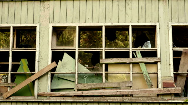 Wall and windows of the abandoned house. Autumn daytime. Smooth dolly shot. video
