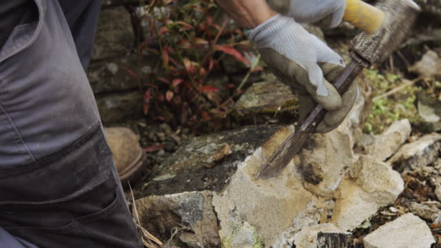 Wall Builder Breaking Apart Large Stone video