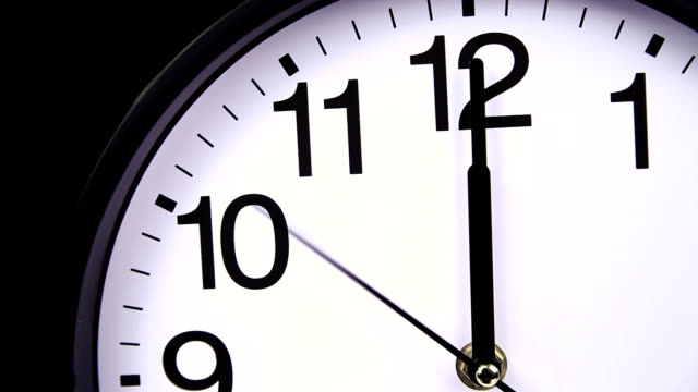 Wall clock on a black 00,00 close-up video