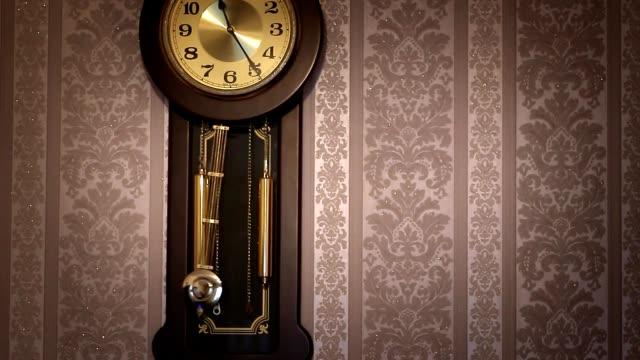 Wall clock with pendulum video