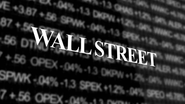 Wall Street Typography over stock Market Ticker background video