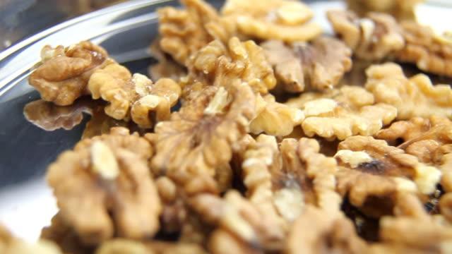 Walnuts on metal plate - loopable, HD video
