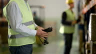 Warehouse Employee Scans Informations From Boxes video