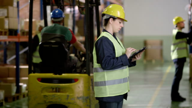 Warehouse Employee Using A Digital Tablet video
