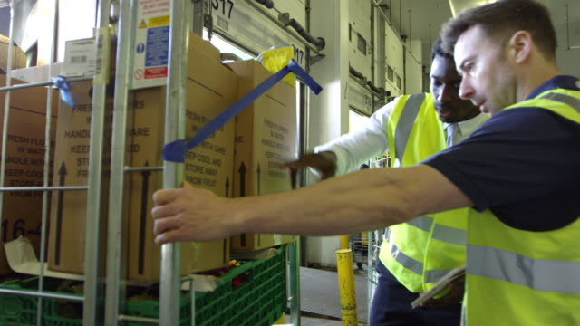 Warehouse manager inspects goods for delivery, shot on R3D video