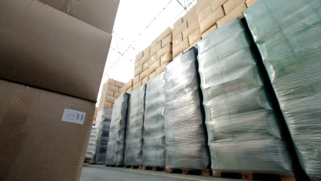 Warehouse With Boxes. Rides Loader video