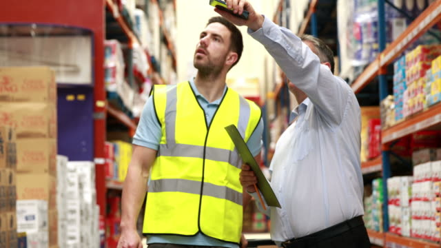 Warehouse worker talking with his manager video