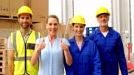 Warehouse worker with thumbs up video