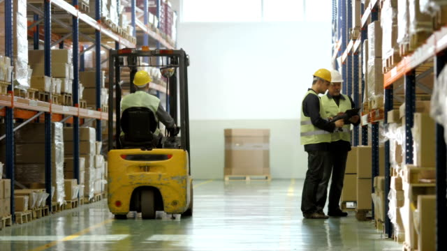 Warehouse Workers Checking The Stock video