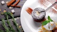 Warm cut chocolate dessert. video
