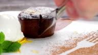 Warm cut chocolate fondant. video