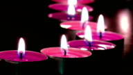 Warm Romantic Pink Candlelight Against Black Background video