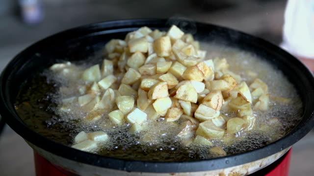 Warming up potatoe in frying pan video