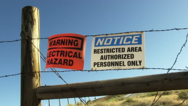 Warning and Restricted signs on Barbed Wire video