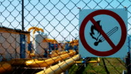 Warning sign on the danger at the natural gas storage and transportation station. Observance of fire safety rules. Gas pipeline with shut-off valves. Fire is prohibited video