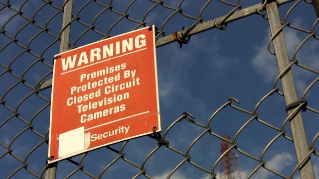 CCTV Warning sign. Timelapse clouds. video