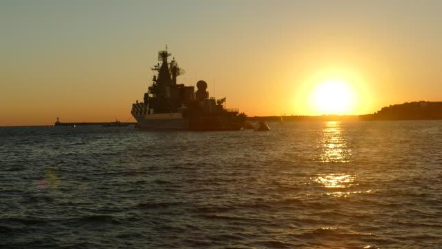 warship at sunset video