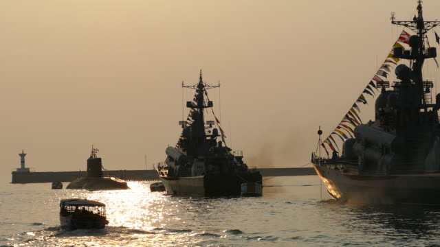 warships in the bay during a beautiful sunset video