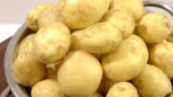 washed potatoes in a colander video