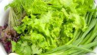 washed vegetables for salad, close up video
