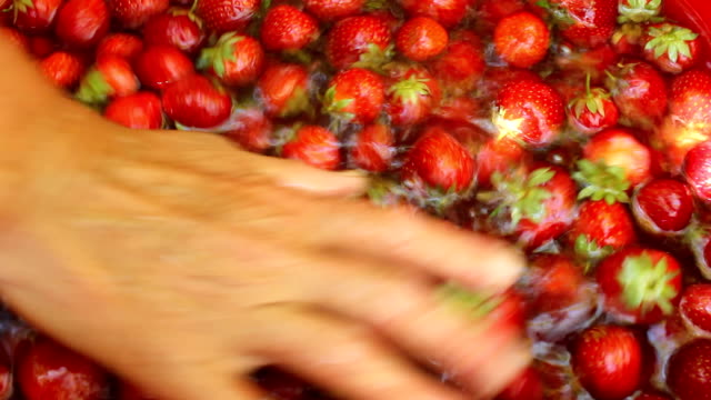Washing a strawberries video