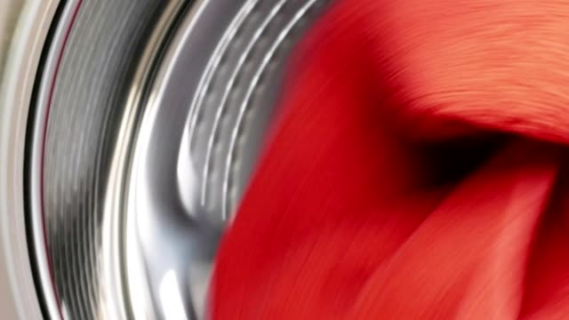 Washing drying machine with red towel in laundry video