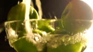 Washing green apples in a glass bowl, slow motion video video