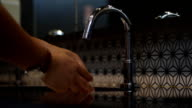 Washing Hands. Cleaning Hands with water form with automatic faucet video