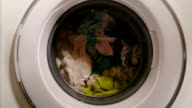 Washing machine full of clothes, home appliance, laundromat video