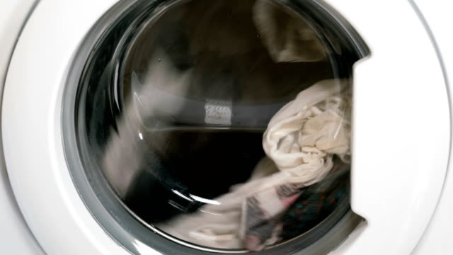 Washing machine is washing clothes video