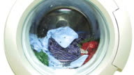 Washing machine with colorful laundry - zoom video