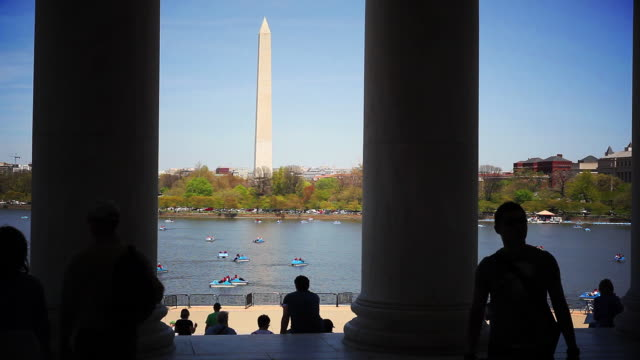 Washinton Monument with backlit tourists video