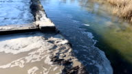 A waste water drainage flow into river. video