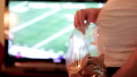 Watching Football And Eating video