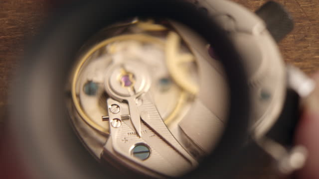 Watchmaker assembling watch video
