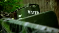 Water 5 gallon tanks in the forest video
