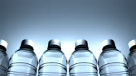 Water bottles slowly moving from right to left. Loopable video